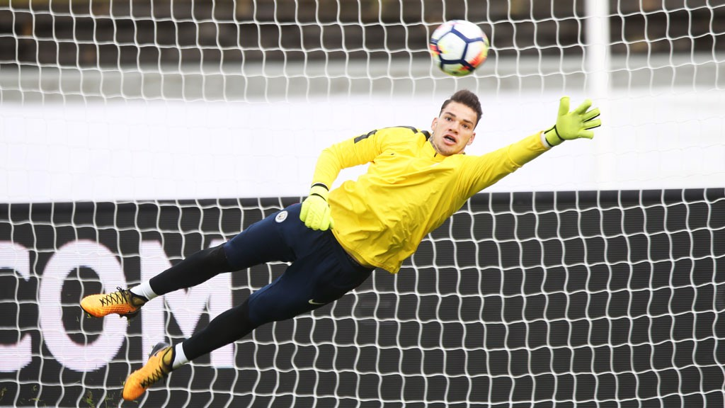 GREAT PICTURE: Ederson stretches out his left arm to save a shot.