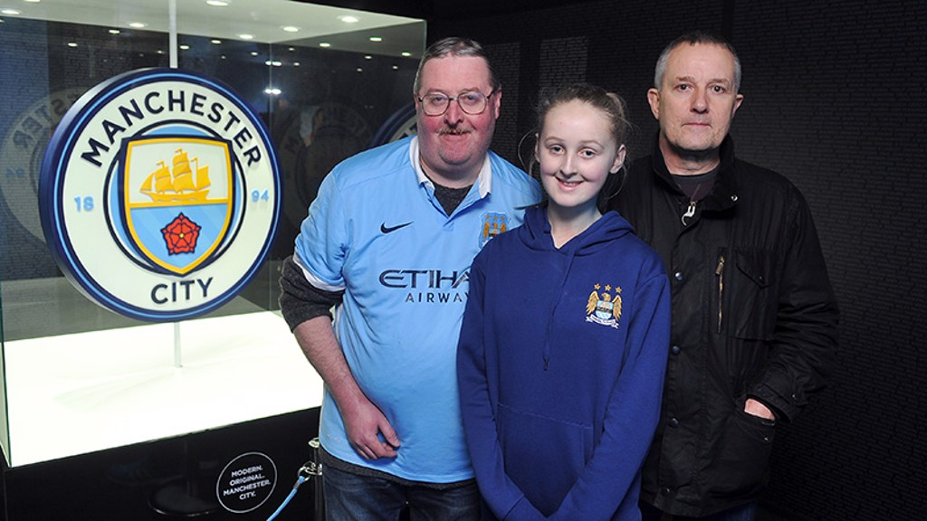 Fans pose with the new badge