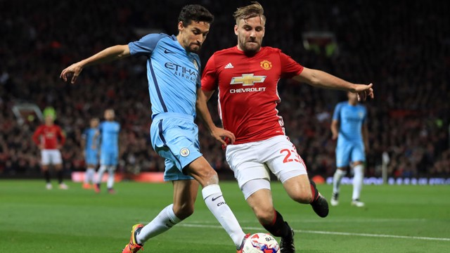 Manchester City's Jesus Navas (left) battles for the ball with Manchester United's Luke Shaw (right)