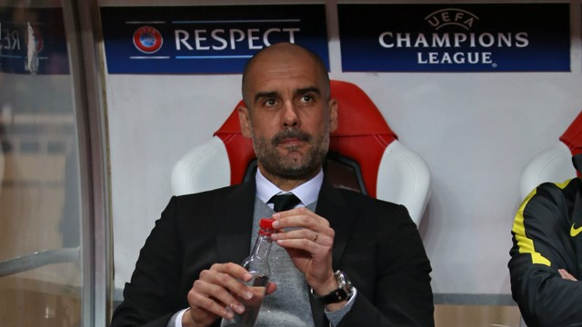 WATCHING ON: Pep sat in the dugout in Stade Louis II