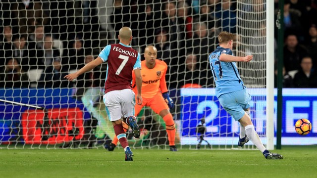 WHAT A FINISH: Kevin De Bruyne slots into the bottom corner for the opener