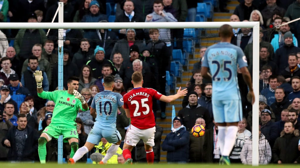 TUCKS IT HOME: Aguero scores his 150th goal for City just before the half-time whistle