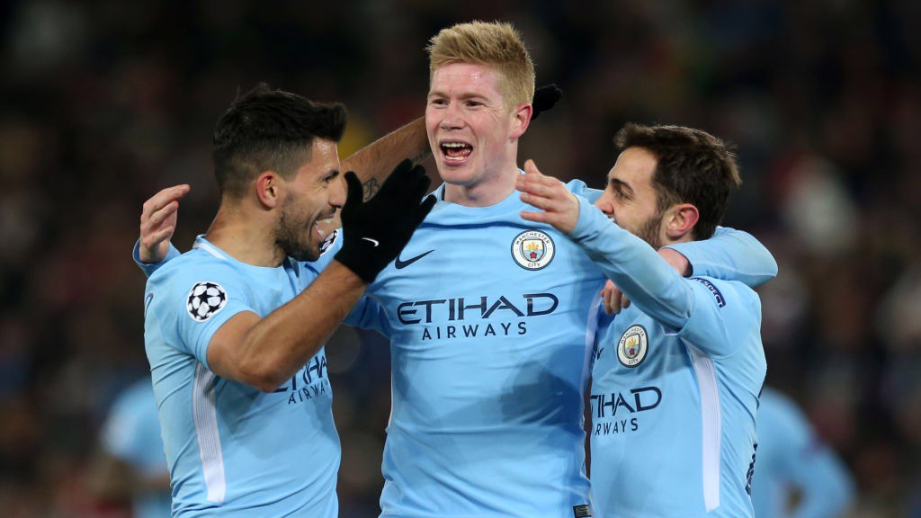 ON FIRE: Kevin De Bruyne and Bernardo Silva congratulate Sergio Agüero on his fifth goal in four days.