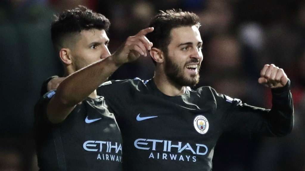 DOUBLE TROUBLE: Sergio Aguero and Bernardo Silva celebrate the Argentine's strike