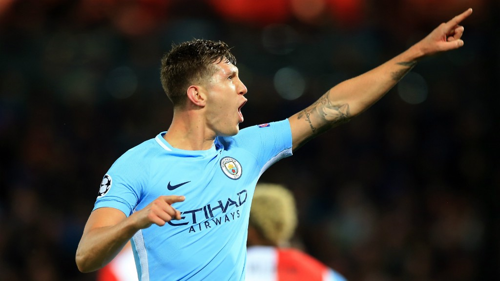 BLUE ARMY: John Stones points to the travelling City fans