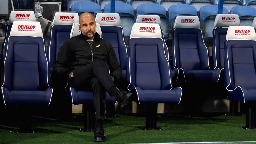 PEP IN POSITION: The manager takes in the warm-up from the bench at the John Smith's stadium.