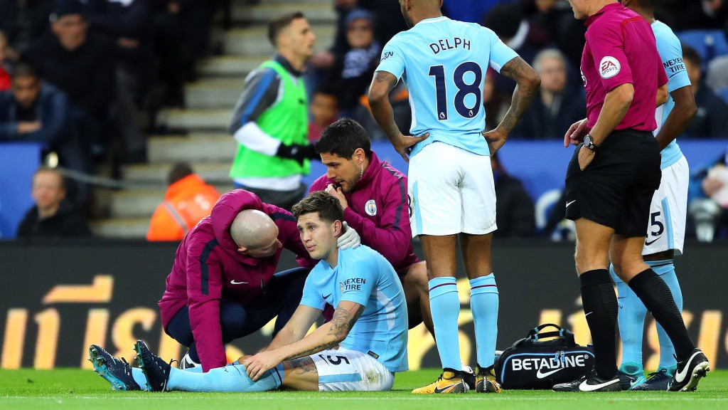 STONES SUBDUED: John Stones is forced off with injury midway through the first half.