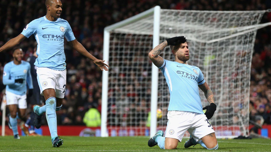 BACK IN FRONT: Nicolas Otamendi slides into his celebration after volleying City ahead on a day of derby delight at Old Trafford