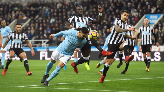 ALL IN: Ilkay Gundogan launches himself at a diving header.