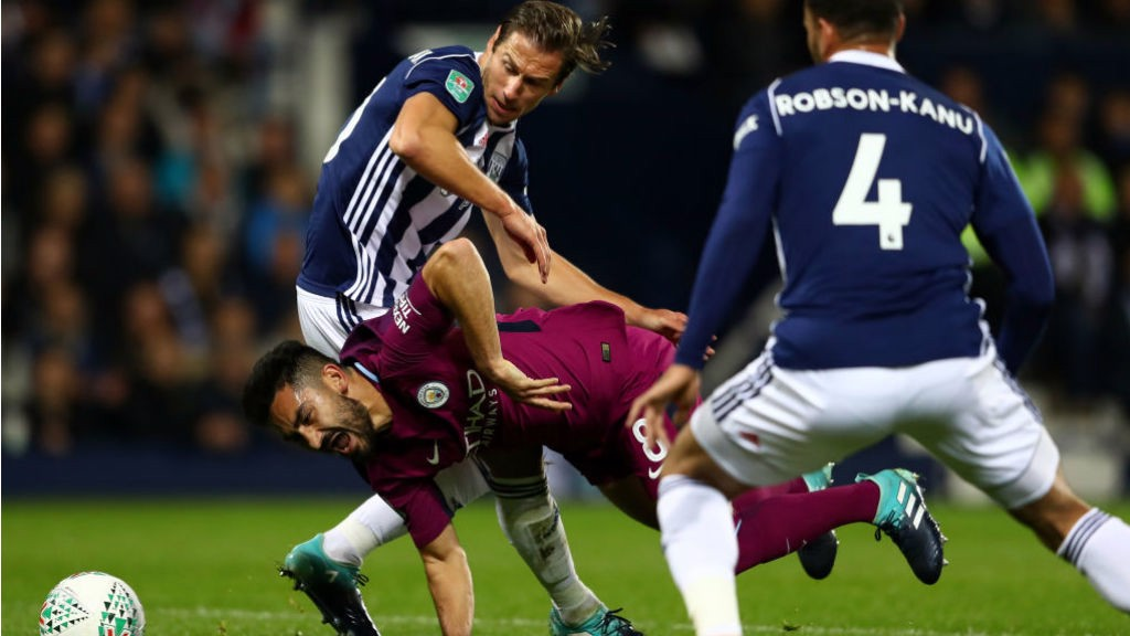 CRASH LANDING: Ilkay Gundogan is sent tumbling as City turn up the pressure