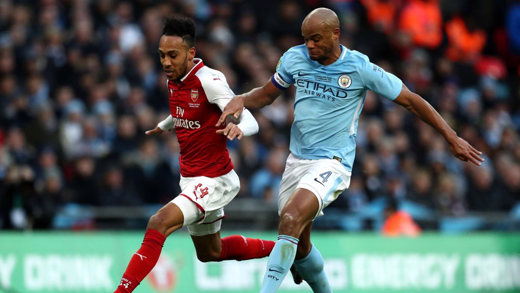 SOLID: Vincent Kompany makes a crucial tackle with Aubameyang through on goal.
