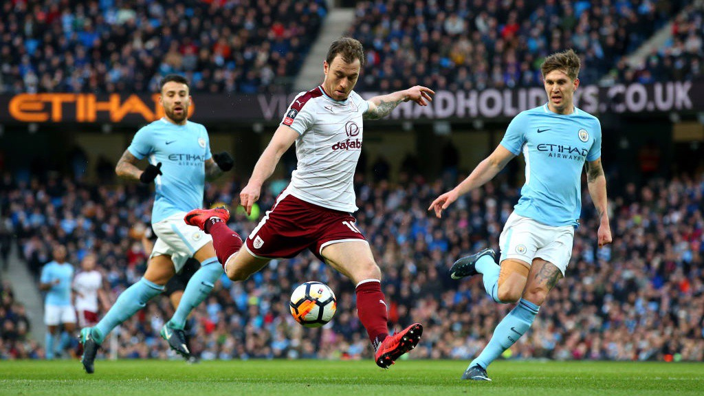 WORK TO DO: Ashley Barnes fires the Burnley into the lead.