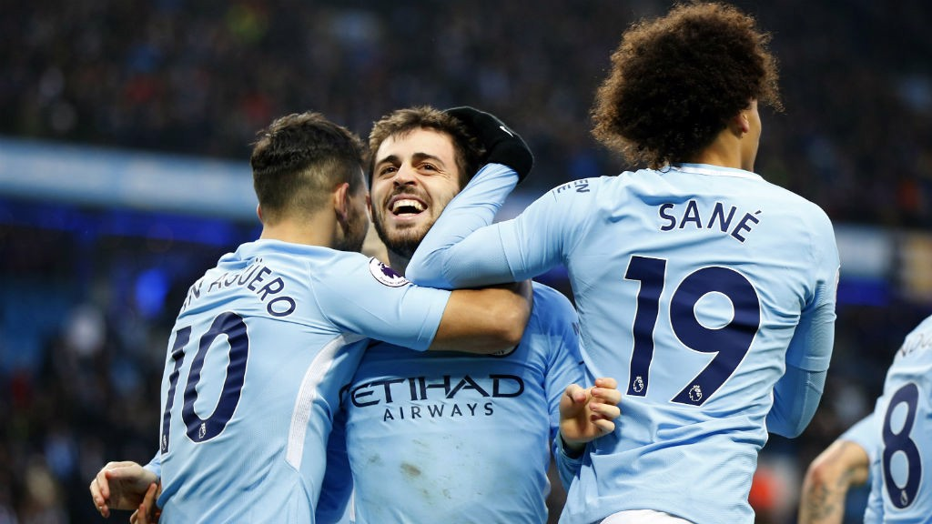 CELEBRATION: Bernardo celebrates his goal with Sergio Aguero and Leroy Sane.