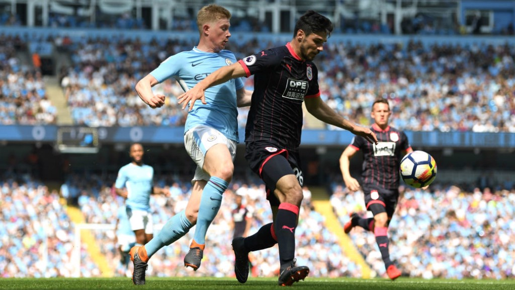 PRESSURE: Kevin De Bruyne looks to regain possession
