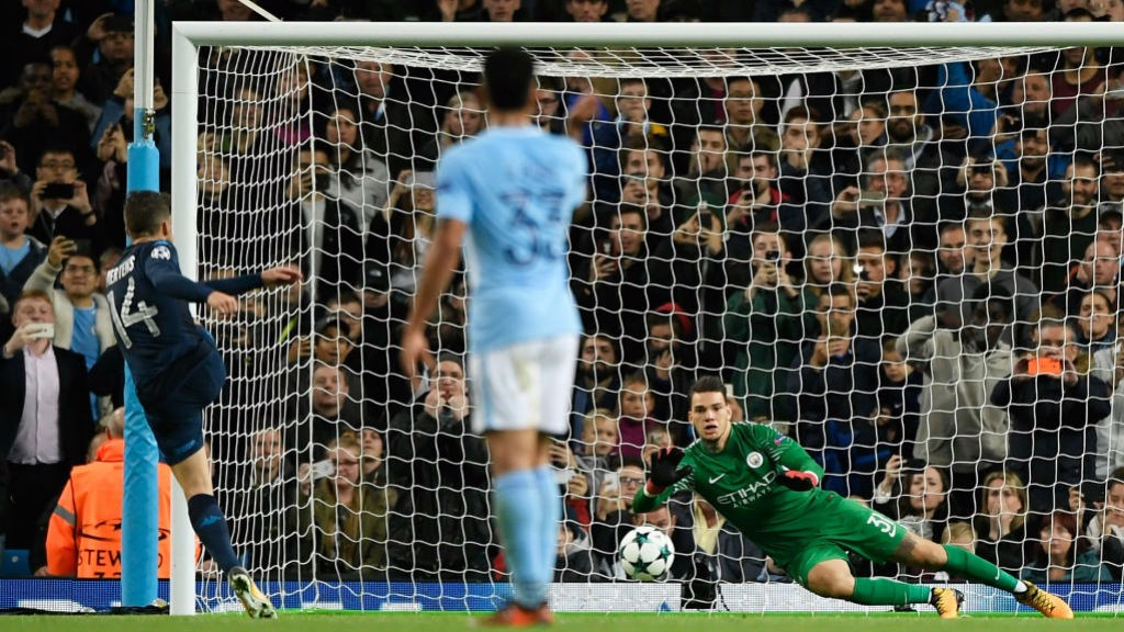 SPOT ON: Ederson dives to keep out Dries Mertens' penalty kick