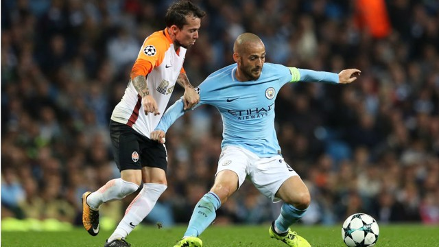 AT FULL STRETCH: David Silva battles it out against Shakhtar Doneskt