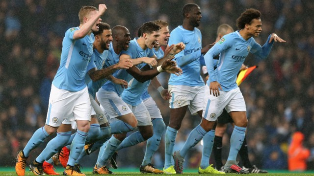 WINNING TEAM: City players celebrate the shoot-out victory