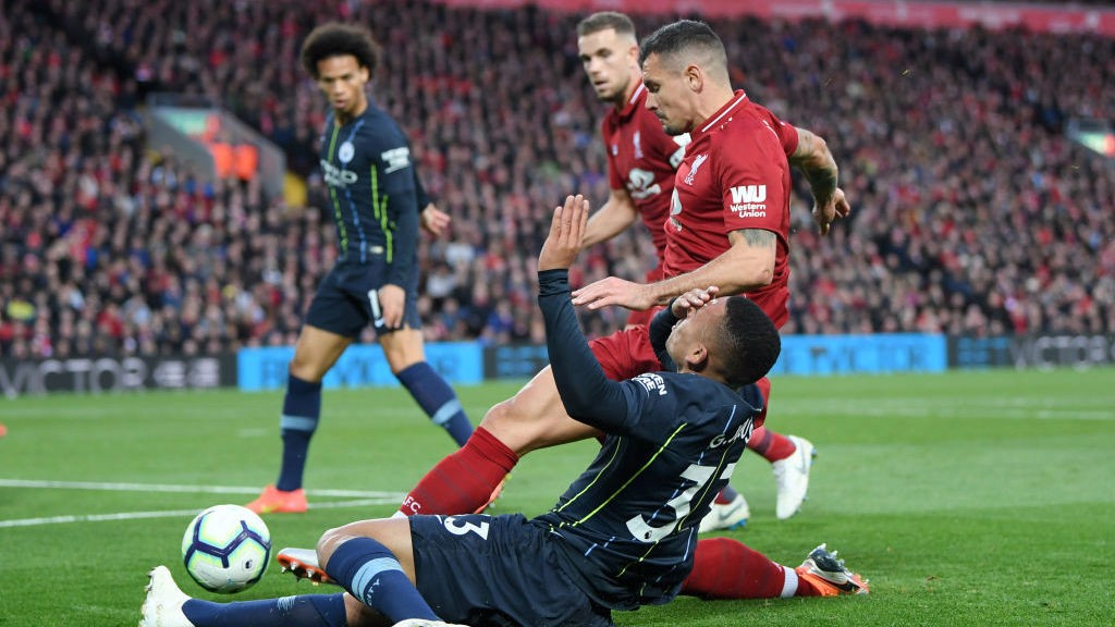 OUCH: Gabriel Jesus feels the force of a Dejan Lovren challenge
