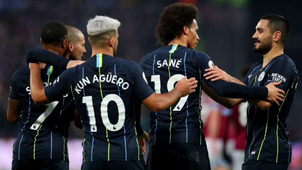 CAPITAL GAINS: The City players celebrate after Leroy Sane's strike