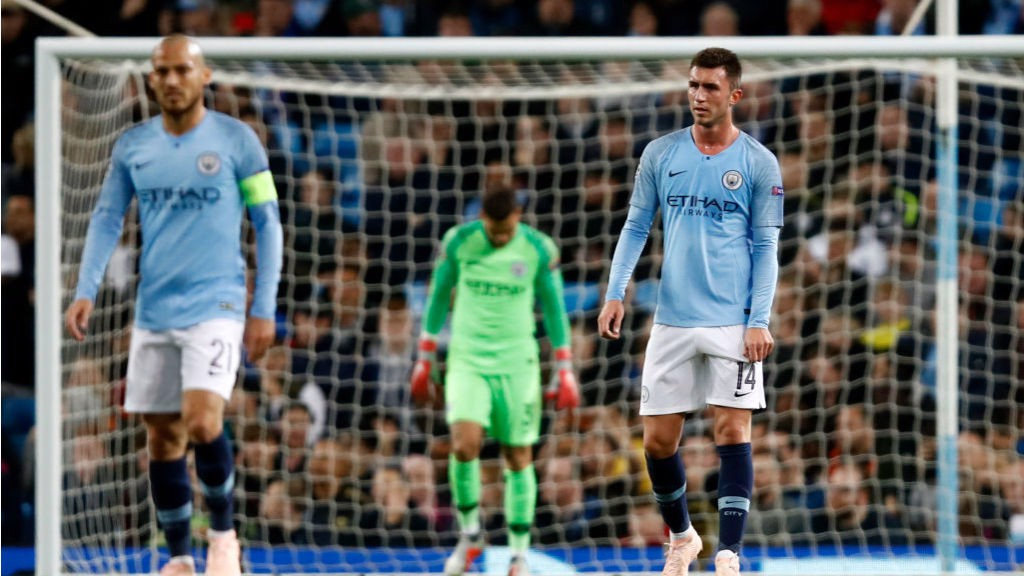 EURO BLOW: The expressions on the City players' faces say it all after Lyon's second goal