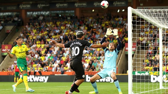 CLOSE: Aguero's header goes just over the bar