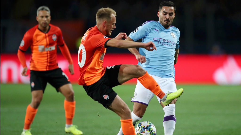 MIDDLES MARCH: Ilkay Gundogan puts the squeeze on the Shakhtar midfield