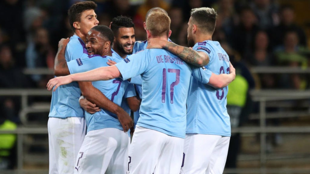 CENTRE OF ATTENTION: Riyad Mahrez is mobbed by his team-mates after his first half goal