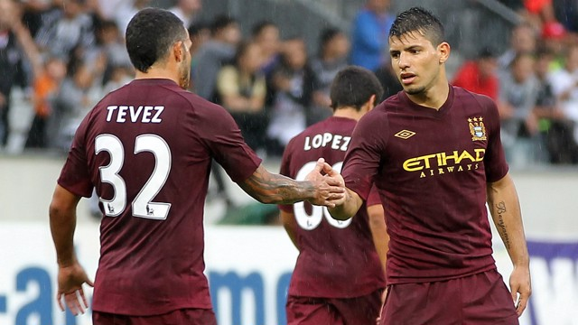 CELEBRATIONS: Carlos Tevez congratulates Sergio Aguero on his opener