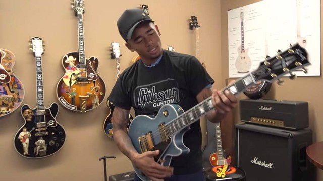 WINNING TUNE: Gabriel Jesus tries out one of the famous Gibson guitars