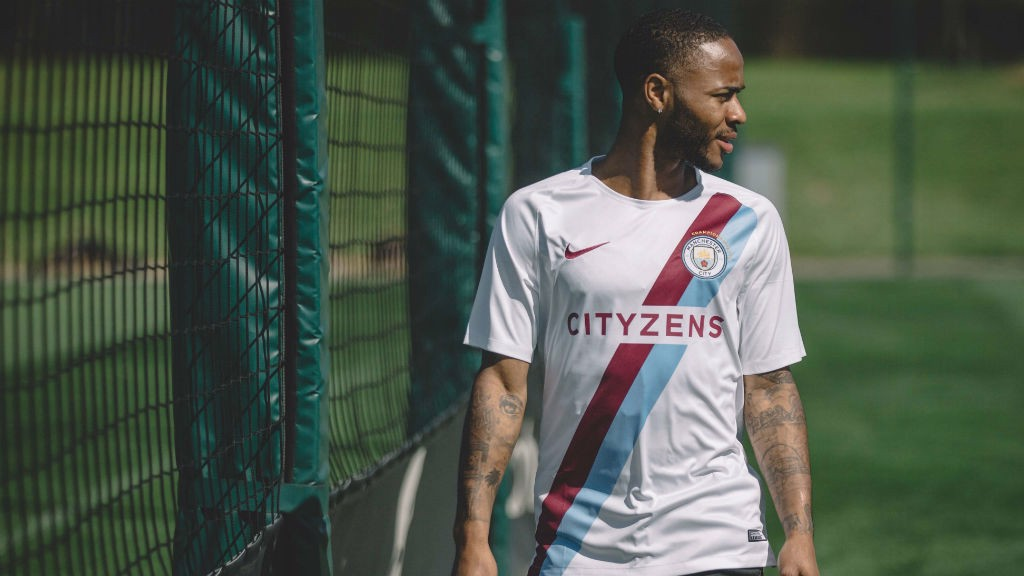 check out c16b1 0dc2a Nike and Man City unveil Champions' shirt