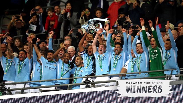 CHAMPIONS: Vincent Kompany lifts the Carabao Cup for the third time as City captain