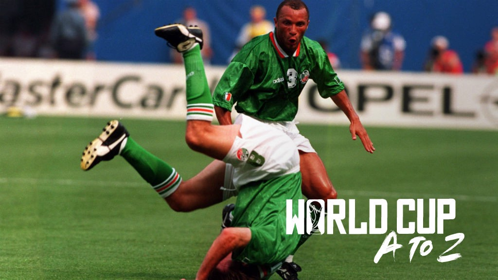 HEAD OVER HEELS: Terry Phelan celebrates Ray Houghton's sensational winner for Italy against Ireland at the 1994 World Cup finals