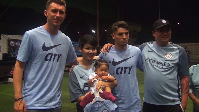 BLUES IN BANGKOK! Aymeric Laporte and Brahim Diaz presented baby Maggie with two new City vests!