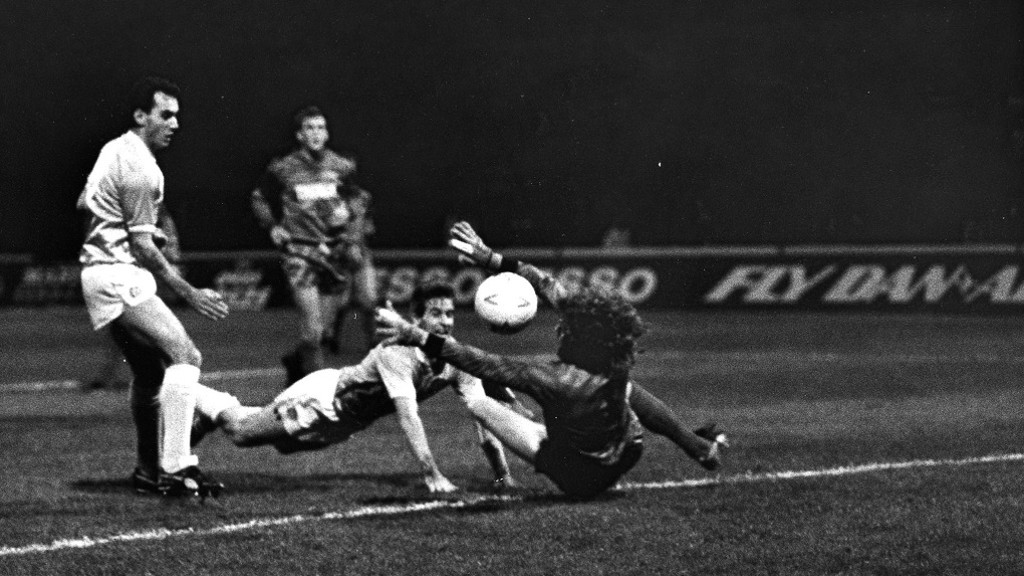 Moulden was a predator in the box - here, he dives to head home while Imre Varadi watches on