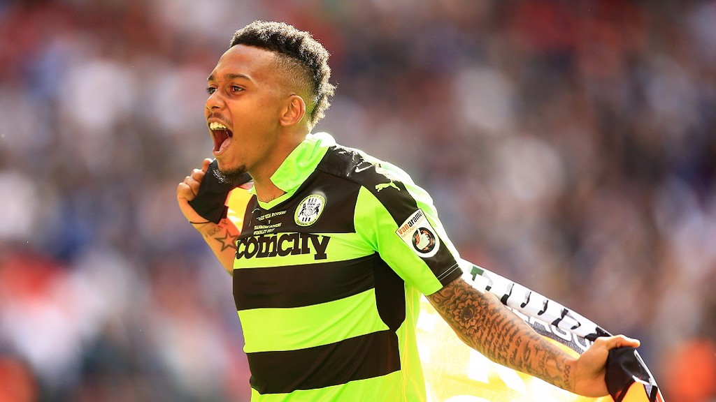 Keanu celebrates a Wembley play-off win with Forest Green